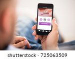 person's hand holding mobile...   Shutterstock . vector #725063509