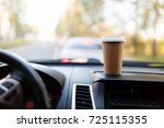 paper cup with coffee on the... | Shutterstock . vector #725115355