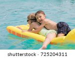 two happy children playing on... | Shutterstock . vector #725204311