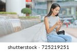 young woman looking at... | Shutterstock . vector #725219251