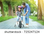 mother teaching her daughter to ... | Shutterstock . vector #725247124