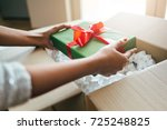 close up of hands holding gift...   Shutterstock . vector #725248825