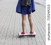 teen girl rides a gyroscope on...   Shutterstock . vector #725249215