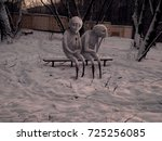 two sad snowman sitting on a... | Shutterstock . vector #725256085