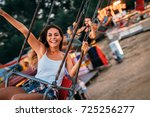 friends having fun at luna park.... | Shutterstock . vector #725256277