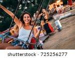 friends having fun at luna park.... | Shutterstock . vector #725256277