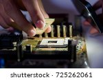 abstract close up of circuits... | Shutterstock . vector #725262061