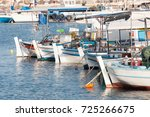 Small photo of 12 April, 2012. Paphos, Cyprus. Boats in the water lap up the sunshine as the tourist season begins.