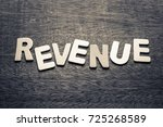 Small photo of Revenue topic by wood letters