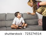 angry mother nags her son...   Shutterstock . vector #725274514