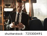 focused young businessman... | Shutterstock . vector #725300491