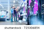 in the electronics store... | Shutterstock . vector #725306854