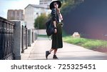 the girl in the hat is standing ... | Shutterstock . vector #725325451