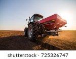 farmer fertilizing arable land... | Shutterstock . vector #725326747