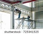 welder man welding the steel... | Shutterstock . vector #725341525
