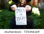 trick or treat paper sack held... | Shutterstock . vector #725346169
