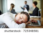 exhausted young woman napping... | Shutterstock . vector #725348581