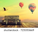 old shabby suitcases on the... | Shutterstock . vector #725353669
