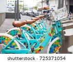 public bikes for tourist people ... | Shutterstock . vector #725371054
