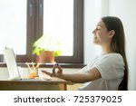 female employee relaxing in... | Shutterstock . vector #725379025