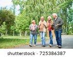joyful group of senior friends... | Shutterstock . vector #725386387