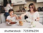 happy family having breakfast... | Shutterstock . vector #725396254