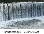 Water Cascade Streaming Down A...