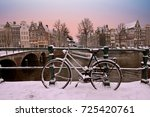 Stock photo sunset in snowy amsterdam in the netherlands in winter 725420761