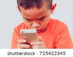 little boy with smartphone.... | Shutterstock . vector #725422345