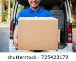 delivery man in blue uniform | Shutterstock . vector #725423179