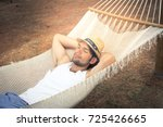 man relaxing outside in a