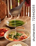 vietnamese traditional meal in... | Shutterstock . vector #725442055