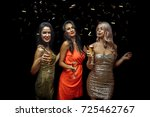 three cheerful young women... | Shutterstock . vector #725462767