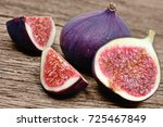fig fruits on wooden table | Shutterstock . vector #725467849
