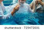 two pastors baptize a man in... | Shutterstock . vector #725472031
