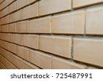 Beige Brick Wall At An Angle...