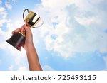 asian boy holding a gold trophy ...   Shutterstock . vector #725493115