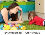 angry baby and tired mother... | Shutterstock . vector #725499031