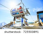 family riding in the ski lift | Shutterstock . vector #725503891