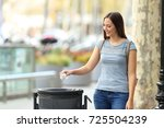 single civic woman throwing a... | Shutterstock . vector #725504239