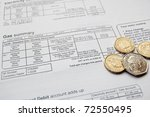 Utility Bill And Coins For...