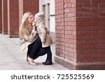 young beautiful mom with her... | Shutterstock . vector #725525569