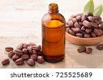 jojoba oil on the wooden board   Shutterstock . vector #725525689