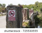 No Swimming sign in French, on a bridge over a tributary of the Charente in Jarnac, France. - stock photo