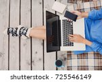 young woman using laptop... | Shutterstock . vector #725546149