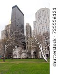 "Small photo of New York City - February 17, 2008: Roxy Paine's ""Conjoined, Defunct and Erratic"" stainless steel tree sculptures in Madison Square Park in New York City"