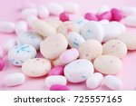 different chewing gums on pink... | Shutterstock . vector #725557165