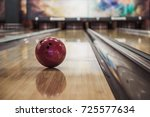 Small photo of Modern bowling room waiting for visitors, balls on bowling alley
