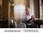 happy young couple eating... | Shutterstock . vector #725593231