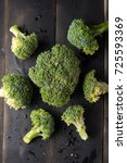 broccoli on black wooden... | Shutterstock . vector #725593369
